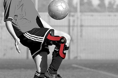 Playing soccer with knee bracing