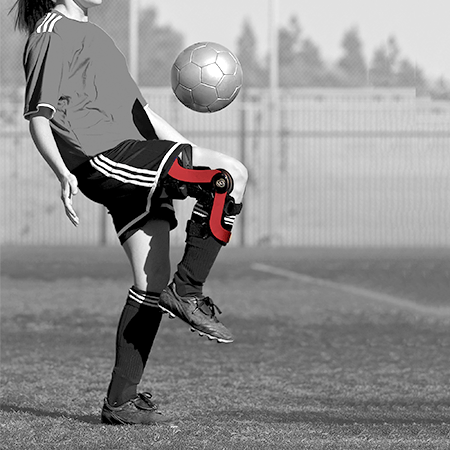 Playing soccer with a knee brace