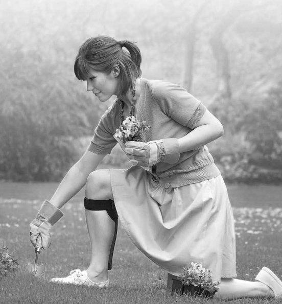 Gardening with leg splint from Walking Mobility Clinics